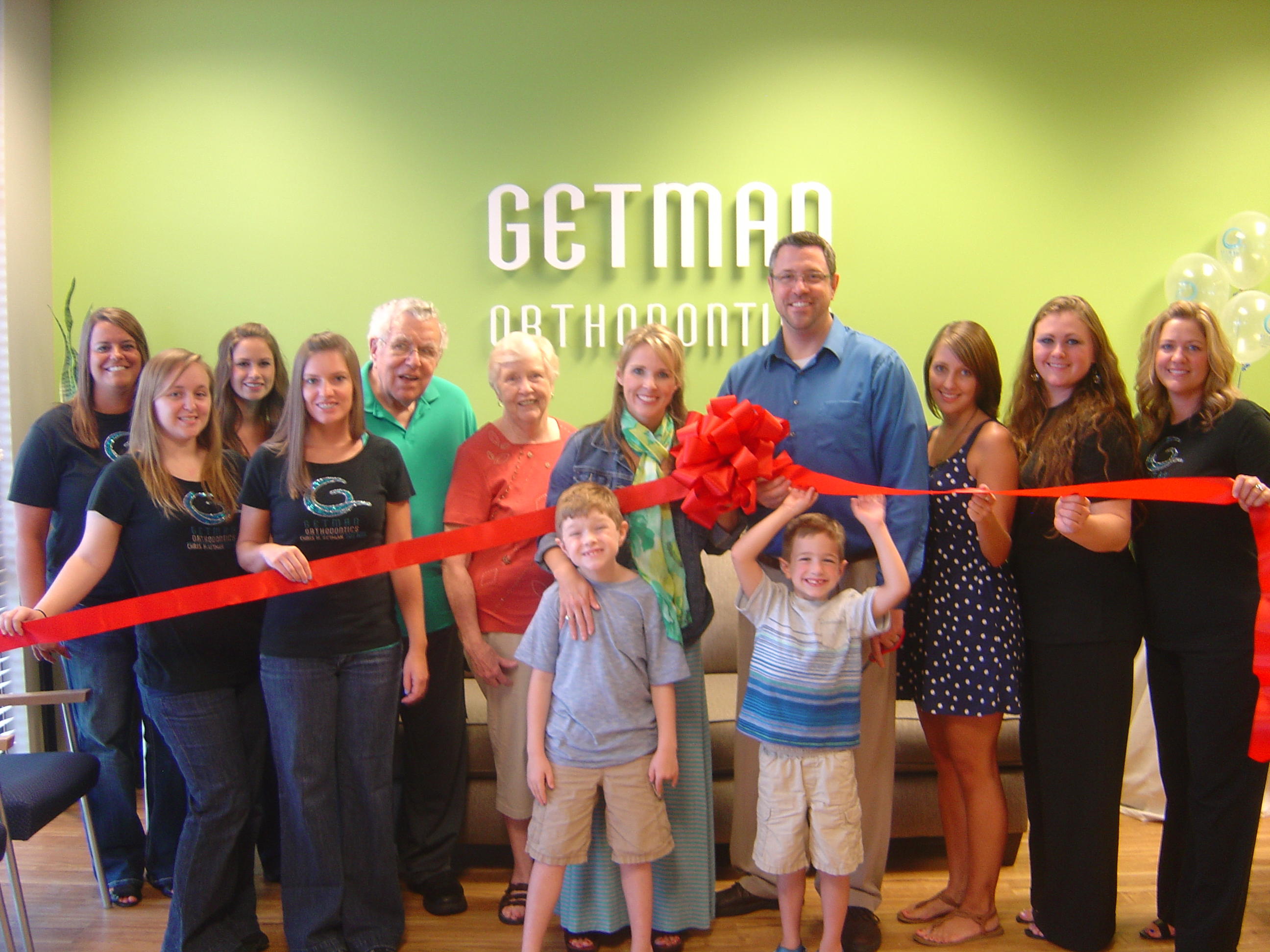 Getman family and staff celebrate Ribbon Cutting at new Arlington office-Jul13